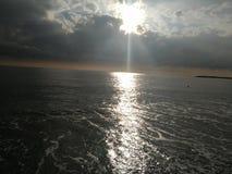 The sea and the sun creates diamonds stock photography
