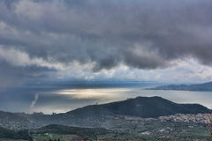 Sea , sun and rainy day. Wonderful view from the mountain pelion in greece royalty free stock images
