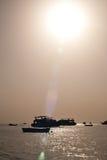 Sea sun ships Stock Photos