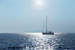 Sea, sun, yacht Stock Images
