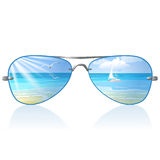 Sea and sunglasses Royalty Free Stock Image