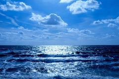 Sea and sunlit sky with clouds stock photo