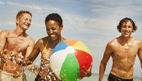 Sea Sunny Vacation Leisure Holiday Friends Concept. Diverse Friends Enjoy Beach Ball Hoiliday Concept royalty free stock photo