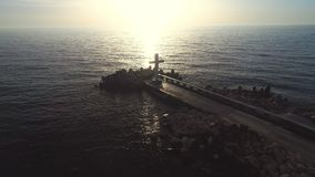 Sea sunrise on the beach and holy Christian cross of the sea horizon, faith is freedom.  stock video footage