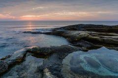 Sea sunrise at the Black Sea coast near Ravda, Bulgaria. Rocky sunrise.  royalty free stock photo