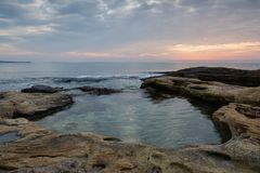 Sea sunrise at the Black Sea coast near Ravda, Bulgaria. Rocky sunrise.  royalty free stock images
