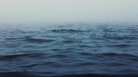 Sea waves. Fog above blue ripple water. Foggy morning