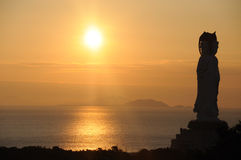 Sea at sunrise with guanyin statue Royalty Free Stock Image