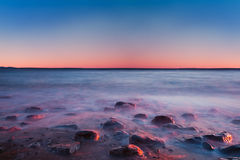 Sea at sunrise with motion blur water Stock Photos