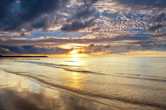 Sea at sunrise with nice waves Stock Photography
