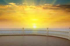 Sea, sunrise and the promenade Royalty Free Stock Image