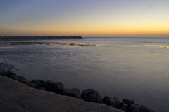 Sea before sunrise. Seascape, sea before sunrise and pier stretching to the horizon Stock Photography