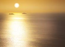 Sea / sunrise / silhouettes of the islands Stock Image