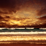 Sea sunset. Magic golden sunset scenery over Pacific Ocean on Sydney beach with cloudy sky, NSW, Australia Stock Photos