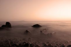 Sea sunset. The effect of the water and the stones in the sea of baja california royalty free stock image
