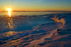 Sea sunset. Sea winter sunset on the shores of the Okhotsk Sea Royalty Free Stock Images
