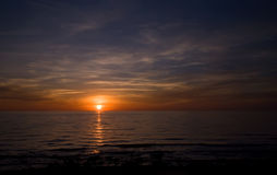 Sea sunset. Baltic sun sky coast clouds Stock Photography