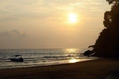 Sunset on sand beach in Tioman island in Malaysia Royalty Free Stock Photography