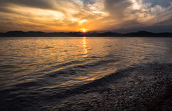 Sea sunset with cloudy sky Royalty Free Stock Image