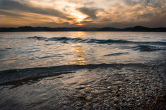 Sea sunset with cloudy sky Stock Photography