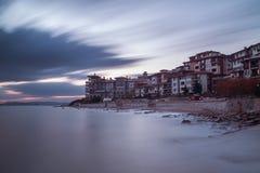 Sea sunset at the coastal city Stock Image