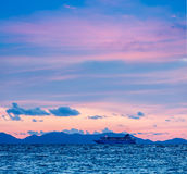 Sea sunset with criuse ship Royalty Free Stock Photos