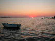 Sea sunset with docks and boats Royalty Free Stock Image