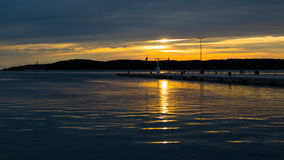 Sea Sunset in Harbour Stock Image
