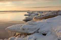 Sea on sunset with icicles Royalty Free Stock Photos
