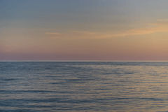 Sea sunset. Sunset over the calm blue sea Royalty Free Stock Photo