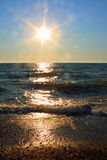 Sea Sunset Picture : Sun beams Scene - Stock Photo. Sea Sunset Picture : Sun beams on evening sky background and yellow waves colored by sunlight Royalty Free Stock Images