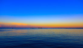 Sea sunset quietly. The calm sea in the sunset sky beautifully Stock Image