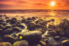 Sea sunset. Sea scape with rocks, long exposure Stock Photo