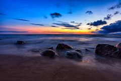 Sea sunset seascape with wet rocks Royalty Free Stock Photos