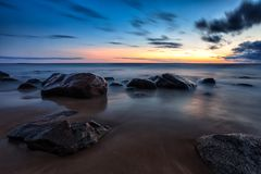 Sea sunset seascape with wet rocks Royalty Free Stock Images