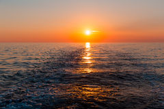 Sea sunset with ship trace Royalty Free Stock Photo