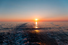 Sea sunset with ship trace Royalty Free Stock Images