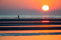 Sea sunset with silhouette person. Sunset silhouette person sky orange sun beach Royalty Free Stock Photos