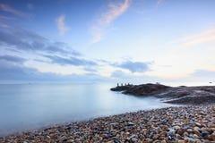 Sea sunset, small stones Stock Photo