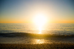 Sea sunset. The sun to set over the horizon reflected in the sea Stock Image