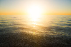 Sea sunset. The sun to set over the horizon reflected in the sea Royalty Free Stock Photo