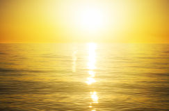Sea sunset. The sun to set over the horizon reflected in the sea Royalty Free Stock Images