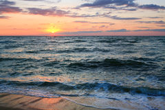 Sea sunset surf wave Stock Image