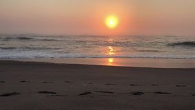 Sea sunset time lapse. Scene with focus on foreground sand beach stock footage