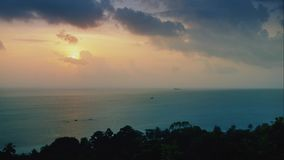 Sunset on the sea in the rainforest from a height. The sea at sunset time on a tropical island in timelapse stock video