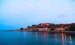 Sea sunset town Stock Image
