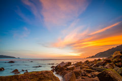 Sea sunset  twilight sky and rock. Sunset on the coast of patong beach ,phuket with rocks in foreground  and twilight sky background Royalty Free Stock Photos