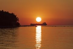 Sea Sunset View With Silhouette Of The Big Ship Stock Images