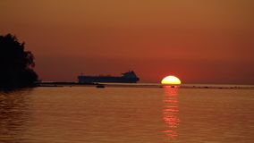 Sea Sunset View With Silhouette Of The Big Ship stock video