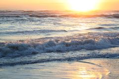 Sea at the sunset. Sunset in the sea waves Royalty Free Stock Images